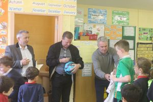 Ronnie and Ray sigh autographs for children at Togher NS